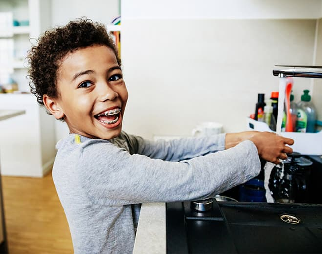 kid washing hands