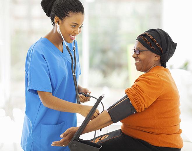 woman taking blood pressure